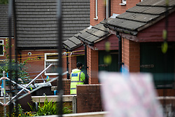 © Licensed to London News Pictures . 15/06/2019. Oldham , UK . Police outside houses nearby to the scene of a Pakistani Community Centre in Glodwick , where a fight broke out during a boxing match last night (14th June 2019) . Photo credit : Joel Goodman/LNP