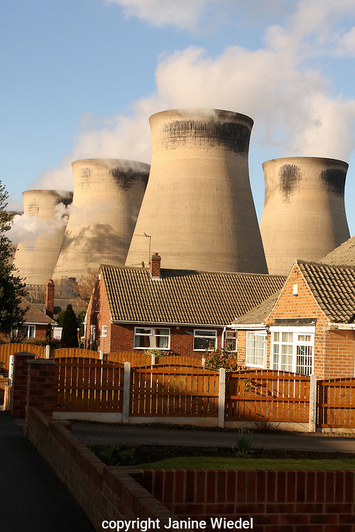 Electricity cooling towers behind domestic residential houses LONDON