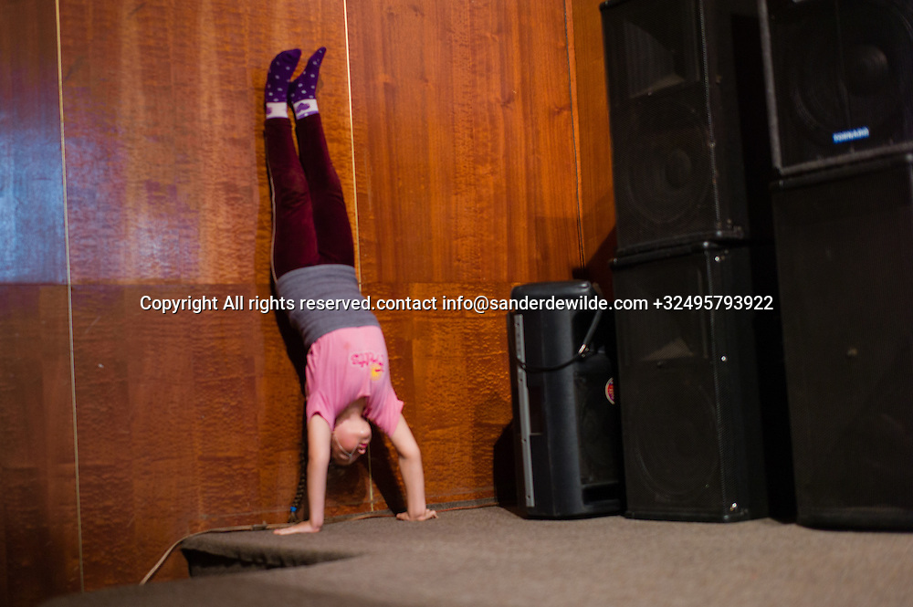 20150826 Bendery, Bender, Transnistria, Moldova.Girl training in theatre for a circis act