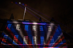 London, UK. 31 January, 2020. Red, white and blue lights are projected onto 10 Downing Street in the moments after the UK left the European Union.