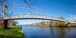 View of pedestrian footbridge over River Nith in Dumfries, Dumfries and Galloway, Scotland, UK