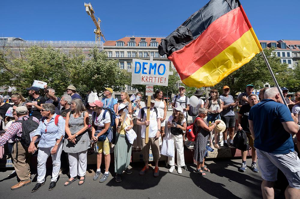 """01 AUG 2020, BERLIN/GERMANY:<br /> Demosntranten mit Kreuz """"Demokratei 1945 - 2020"""" und Deutschland-Flagge, Demonstration gegen die Einschraenkungen in der Corona-Pandemie durch die Initiative """"Querdenken 711"""" aus Stuttgart unter dem Motto """"Das Ende der Pandemie - Tag der Freiheit"""", Unter den Linden<br /> IMAGE: 20200801-01-015<br /> KEYWORDS: Demo, Protest, Demosntranten, Protester, COVID-19, Corona-Demo"""