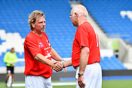 Tommy Charlton of England over 60's shakes hands with Spencer Pratten (Captain) of England at full time during the world's first Walking Football International match between England and Italy at the American Express Community Stadium, Brighton and Hove, England on 13 May 2018. Picture by Graham Hunt.