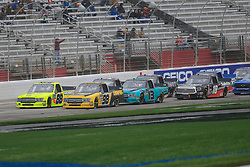 February 23, 2019 - Hampton, GA, U.S. - HAMPTON, GA - FEBRUARY 23:  #98: Grant Enfinger, ThorSport Racing, Ford F-150 Champion Power Equipment leads the other ThorSport trucks on a restart during the 11th running of the Ultimate Tailgating 200 NASCAR Gander Outdoors Truck Series race on February 23, 2019 at the Atlanta Motor Speedway in Hampton, GA.  (Photo by David J. Griffin/Icon Sportswire) (Credit Image: © David J. Griffin/Icon SMI via ZUMA Press)