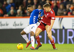Rangers Jermain Defoe (left) and Aberdeen's Tommie Hoban (right) during the Ladbrokes Scottish Premiership match at Pittodrie Stadium, Aberdeen.