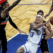ORLANDO, FL - APRIL 12: R.J. Hampton #13 of the Orlando Magic attempts a shot past Dejounte Murray #5 of the San Antonio Spurs and Patty Mills #8 of the San Antonio Spurs during the second half at Amway Center on April 12, 2021 in Orlando, Florida. NOTE TO USER: User expressly acknowledges and agrees that, by downloading and or using this photograph, User is consenting to the terms and conditions of the Getty Images License Agreement. (Photo by Alex Menendez/Getty Images)*** Local Caption *** R.J. Hampton; Dejounte Murray; Patty Mills