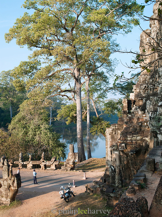 Modern guards stand outside the South Gate of the Angkor temple complex, Siem Reap Province, Cambodia