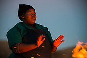 Local person at fire<br /> Private game ranch<br /> Great Karoo<br /> SOUTH AFRICA