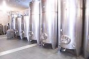 Stainless steel fermentation tanks in varying sizes in the winery. Vukoje winery, Trebinje. Republika Srpska. Bosnia Herzegovina, Europe.