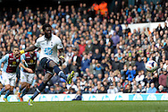 Tottenham Hotspur's Emmanuel Adebayor shoots and scores from a penalty . Barclays premier league match ,Tottenham Hotspur v Aston Villa at White Hart Lane in Tottenham, London  on Sunday 11th May 2014.<br /> pic by John Patrick Fletcher, Andrew Orchard sports photography.