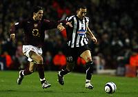 Photo: Chris Ratcliffe.<br /> Arsenal v Juventus. UEFA Champions League. Quarter-Finals. 28/03/2006.<br /> Cesc Fabregas closes down Gianluca Zambrotta of Juventus