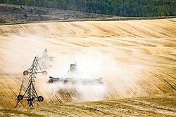 A farmer tilling  his field in Eastern Idaho