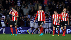 Sunderland's John O'Shea (left), Sunderland's Jan Kirchoff (centre), Sunderland's Lynden Gooch (second right) and Sunderland's Ducan Watmore (right) appear dejected after Queens Park Rangers' Sandro (not in picture) scores his side's first goal of the game during the EFL Cup, Third Round match at Loftus Road, London.