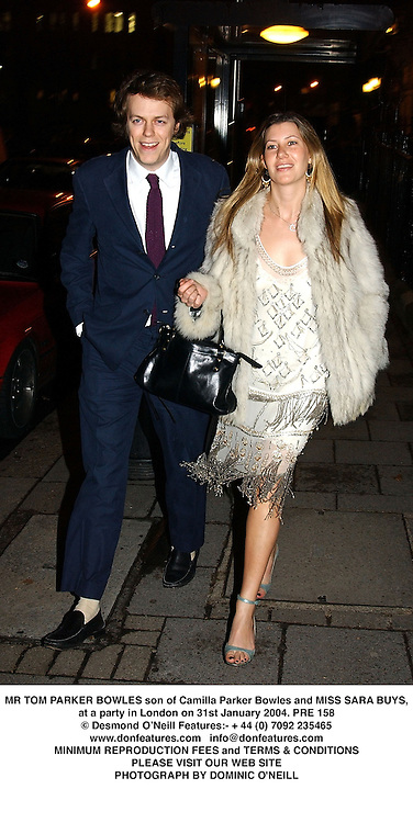 MR TOM PARKER BOWLES son of Camilla Parker Bowles and MISS SARA BUYS, at a party in London on 31st January 2004.PRE 158