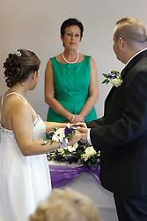 Bride who has cerebral palsy, with Groom, taking their vows in front of registrar.
