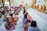 31 OCTOBER 2012 - YARANG, PATTANI, THAILAND: Monks at Wat Kohwai lead an Ok Phansa service before villagers left the temple on a procession to Yala. Ok Phansa marks the end of the Buddhist 'Lent' and falls on the full moon of the eleventh lunar month (October). It's a day of joyful celebration and merit-making. For the members of Wat Kohwai, in Yarang District of Pattani, it was a even more special because it was the first time in eight years they've been able to celebrate Ok Phansa. The Buddhist community is surrounded by Muslim villages and it's been too dangerous to hold the boisterous celebration because of the Muslim insurgency that is very active in this area. This the year the Thai army sent a special group of soldiers to secure the village and accompany the villagers on their procession to Yala, a city  about 20 miles away.   PHOTO BY JACK KURTZ