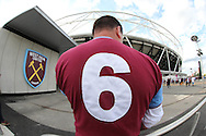 a West Ham United fan proudly shows off his Bobby Moore No.6 shirt outside the London Stadium before k/o. UEFA Europa league, 3rd qualifying round match, 2nd leg, West Ham Utd v NK Domzale at the London Stadium, Queen Elizabeth Olympic Park in London on Thursday 4th August 2016.<br /> pic by John Patrick Fletcher, Andrew Orchard sports photography.