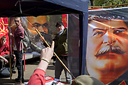 Members of the Communist Party of Great Britain gather with the faces of Karl Marx and Soviet leader Josef Stalin on banners in Trafalgar Square during the traditional May Day celebrations in the capital, on 1st May 2018, in London, England.