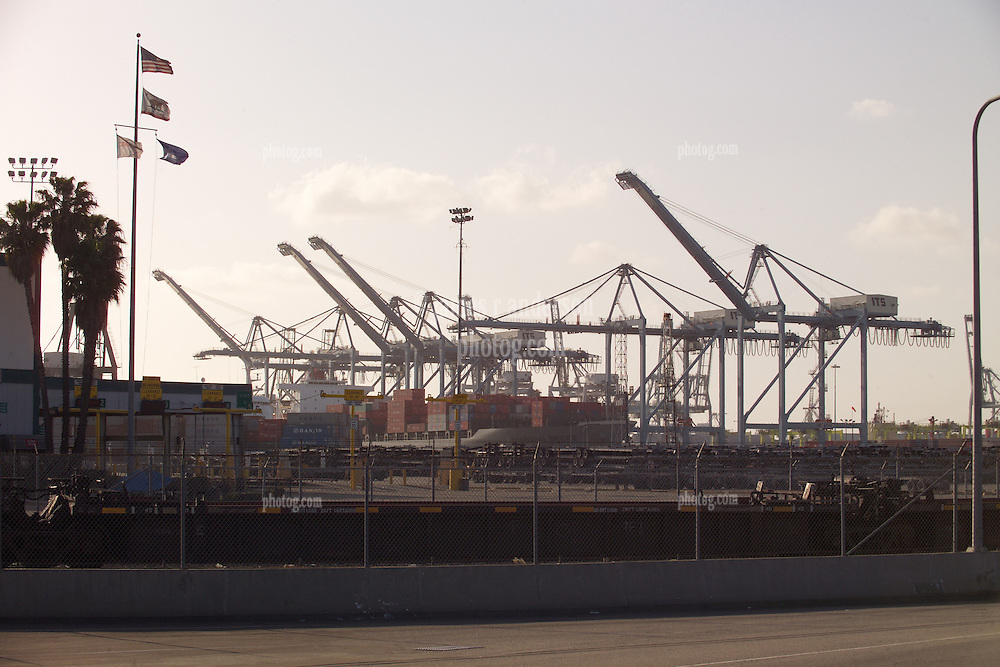Operations, Ship, Flags & Golden Sky. The Port of Long Beach at Sunset. Rail Cranes and Ship in Port.
