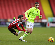 Stefan Scougall of Sheffield Utd is fouled during the English League One match at Bramall Lane Stadium, Sheffield. Picture date: December 31st, 2016. Pic Simon Bellis/Sportimage