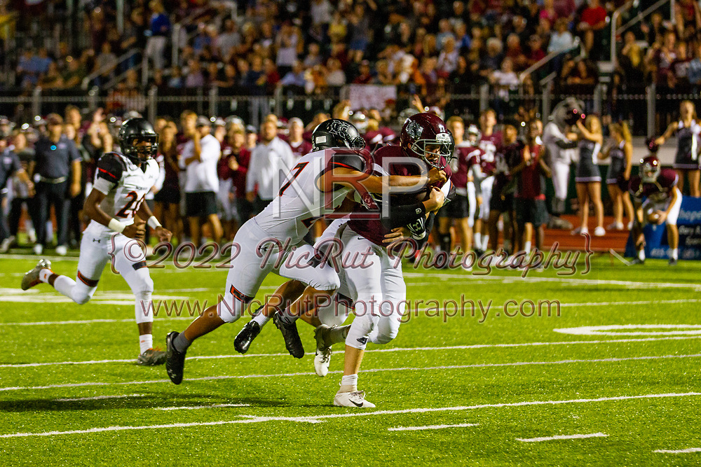 Edmond's Andrew Horton tackled by Norman's Jaedan Ford during the game in Edmond on Friday, October 05, 2018.