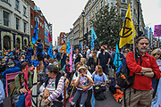 Members of the Extinction Rebellion set up a camp at the busy junction on St Martin's Lane near Covent Garden in central London on Monday, Aug 23, 2021. (VX Photo/ Vudi Xhymshiti)