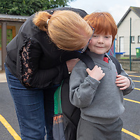 Michael O'Reilly gets a kiss from his mum Ann- Marie