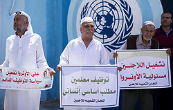 September 6, 2017 - Gaza City, The Gaza Strip, Palestine - Members of the Joint Commission for Refugees hold banners during a protest to demand their rights in Gaza city. (Credit Image: © Mahmoud Issa/Quds Net News via ZUMA Wire)