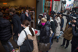 © Licensed to London News Pictures.  12/04/2021. London, UK. Shoppers are seen getting into TK max at Oxford Street, central London as the government takes the next step on its lockdown-lifting road map and non-essential shops re-open today. Photo credit: Marcin Nowak/LNP