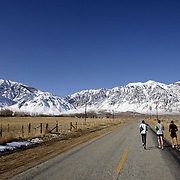 BISHOP, CA, January 19, 2008: Ryan Hall, in white shirt, trains for the Olympics with Mike McKeeman, middle, and Steve Slattery, at the base of the Eastern Sierra mountains outside the town of Bishop, California about 30 miles from Mammoth Lakes. The high altitude and clean air provide a picturesque and challenging training ground for the Olympic hopeful.