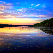A Wisconsin summer sunset on Long Lake in the northern part of Kettle Moriane forrest. Photo by Jennifer Rondinelli Reilly. All Rights Resrved. NO USE WITHOUT PERMISSION.