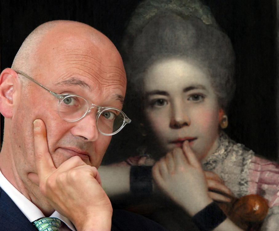 """5/17/10 Trumbull<br /> ML0605<br /> Angus Trumble, Yale Center for British Art curator of paintings and sculpture, has written a book on the finger and its depictions in art. He's photographed here in the YCBA with Sir Joshua Reynolds' 18thc. portrait """"Mrs. Abington as Miss Prue."""" Photo by Mara Lavitt"""