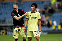 Football - 2021 / 2022 Premier League - Burnley vs. Arsenal<br /> <br /> Rob Holding and Takehiro Tomiyasu of Arsenal share a joke after the final whistle after the game, at Turf Moor.<br /> <br /> <br /> COLORSPORT/ALAN MARTIN