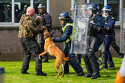 South Queensferry,, Scotland, UK. 16th September 2021. Police Scotland invite the press to witness their ongoing public order training at Craigiehall Camp at South Queensferry. The training is designed to prepare police for the upcoming COP26 event in Glasgow in November where protests are anticipated. Police in riot gear faced up  against police taking the role of protesters throwing missiles and attacking them with clubs. Pic; Police dogs in action.   Iain Masterton/Alamy Live News.