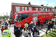 The Liverpool coaches arrive  as fans celebrate outside the stadium and through the city before and during the Premier League match between Liverpool and Aston Villa at Anfield, Liverpool, England on 5 July 2020.