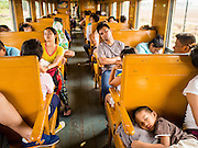 20 MARCH 2015 - KABIN BURI, PRACHINBURI, THAILAND: A 3rd class train going to Kabin Buri. The State Railways of Thailand (SRT), established in 1890, operates 4,043 kilometers of meter gauge track that reaches most parts of Thailand. Much of the track and many of the trains are poorly maintained and trains frequently run late. Accidents and mishaps are also commonplace. Successive governments, including the current military government, have promised to upgrade rail services. The military government has signed contracts with China to upgrade rail lines and bring high speed rail to Thailand. Japan has also expressed an interest in working on the Thai train system. Third class train travel is very inexpensive. Many lines are free for Thai citizens and even lines that aren't free are only a few Baht. Many third class tickets are under the equivalent of a dollar. Third class cars are not air-conditioned.   PHOTO BY JACK KURTZ