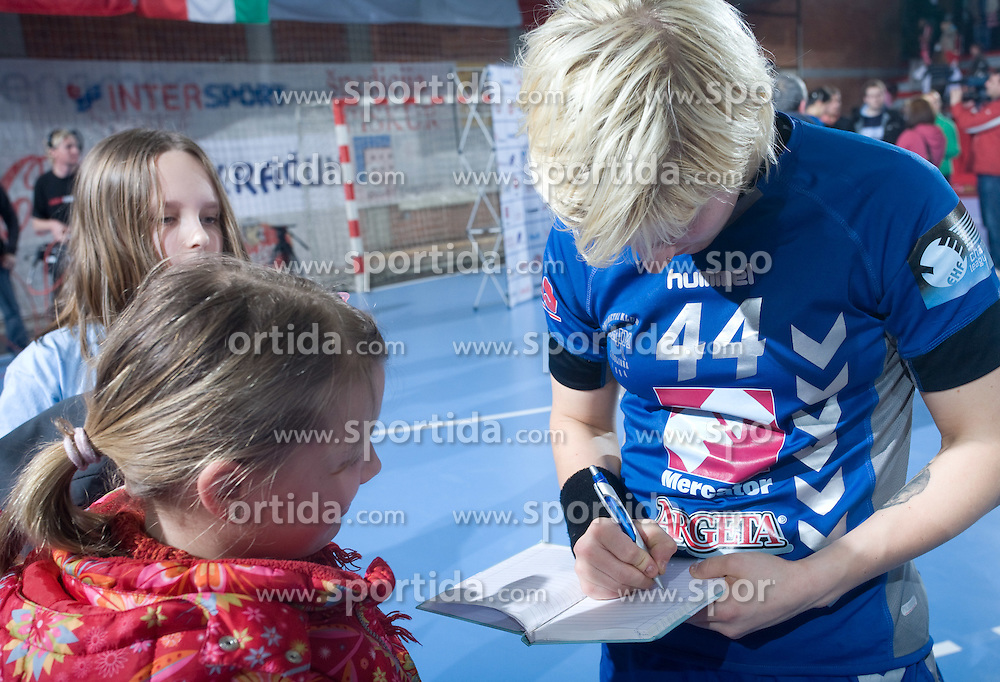 Maja Zrnec signing autographs after EHF Champions league handball match in Group II between RK Krim Mercator and Gyori Audi Eto KC, on February 7, 2009, in Kodeljevo, Ljubljana, Slovenia. Gyori won 35:31. (Photo by Vid Ponikvar / Sportida)
