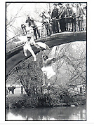 Greg Supra and Dotty Smith, Jumping into the river. May morning Oxford.1 May 1983. Party partly organised by Ding Boston, Film 83234f17<br />© Copyright Photograph by Dafydd Jones<br />66 Stockwell Park Rd. London SW9 0DA<br />Tel 0171 733 0108