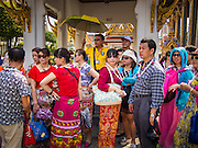 15 OCTOBER 2014 - BANGKOK, THAILAND: A group of Chinese tourists in the Grand Palace in Bangkok. The number of tourists arriving in Thailand in July fell 10.9 per cent from a year earlier, according to data from the Department of Tourism. The drop in arrivals is being blamed on continued uncertainty about Thailand's political situation. The tourist sector accounts for about 10 per cent of the Thai economy and suffered its biggest drop in visitors in June - the first full month after the army took power on May 22. Arrivals for the year to date are down 10.7% over the same period last year.   PHOTO BY JACK KURTZ