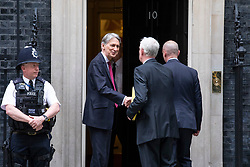 © Licensed to London News Pictures. 04/06/2018. London, UK. The Chancellor of The Exchequer Philip Hammond (2-L) greets business leaders outside 10 Downing Street before a meeting with Prime Minister Theresa May, Secretary of State for International Trade Liam Fox and Secretary of State for Exiting the European Union David Davis. Photo credit: Rob Pinney/LNP
