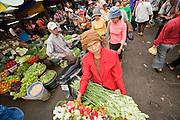 14 MARCH 2006 - PHNOM PENH, CAMBODIA: A flower vendor in the pasr char or Old Market in central Phnom Penh, Cambodia. Photo by Jack Kurtz / ZUMA Press