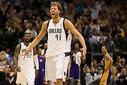 Dirk Nowitzki (41) of the Dallas Mavericks celebrates after a made three-pointer in the 4th quarter against the Los Angeles Lakers at the American Airlines Center in Dallas on Sunday, February 24, 2013. (Cooper Neill/The Dallas Morning News)