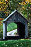 Charming covered bridge and autumn foliage, Vermont, USA.