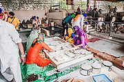 People prepare food in the kitchen of the Golden temple in Amritsar, Punjab province, India. This kitchen feeds the many pilgrims