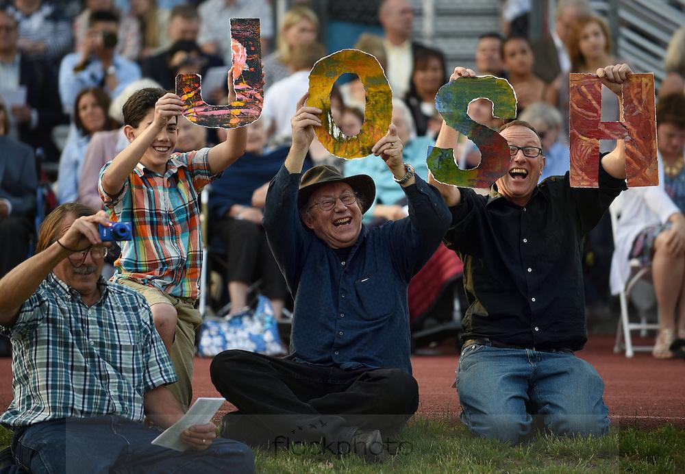(l-r) Maceo Hertz-Velasquez, David Halladay, and Peter Halladay cheer on Wellesley High School senior Josh Wolkoff during the school's graduation ceremony, June 3, 2016.<br /> Wicked Local staff photo / Kate Flock