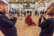 Aluminum - New York-based choreographer Rashida Bumbray (pictured red dress) collaborates with Simone Leigh on an immersive danceperformance. The performance begins in the Tanks at and proceeds through the Switch House, pausing on Level 4 around and concluding in Tate Exchange. London 26 Nov 2016.