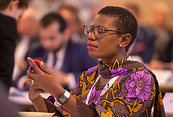 © Licensed to London News Pictures. 22/10/2018. Bristol, UK. Global Parliament of Mayors Annual Summit, 21-23 October 2018, at Bristol City Hall. Picture of YVONNE AKI-SAWYERR, mayor of Freetown, Sierra Leone. The Global Parliament of Mayors 2018 is the biggest and most ambitious Annual Summit to date. GPM Bristol 2018 will host up to 100 global mayors for an action-focused summit that addresses some of the biggest challenges facing today's world cities. GPM Bristol 2018's theme, Empowering Cities as Drivers of Change, will focus minds on global governance and the urgent need for the influence, expertise and leadership of cities to be felt as international policy is shaped. GPM Bristol 2018 will provide mayoral delegates with a global network of connections and a space to develop the collective city voice necessary to drive positive change. The programme will engage participants in decision-making, with panels, debate and voting on priority issues including migration and inclusion, urban security and health, and is a unique chance to influence decisions on the most pressing issues of our time. Photo credit: Simon Chapman/LNP