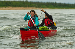 Dene First Nation youth Shonto Catholique, 21, back and Amber Lynn Powder, 20 paddle down the Thelon river In the middle of the largest and most remote game sanctuary in North America, in the Northwest Territories, just south of the Arctic Circle. Its fate now hangs in the balance, protected on paper, but with little management, no money, and no voice for the Dene, its most ardent advocate for protection, while mining (for diamonds, gold, and uranium) threats, buoyed by recent prices, loom.  Dene youth have rarely been deep into the Thelon, yet the caribou is still their life blood, reverentially important.  These Dene are amongst the last hunter/gatherers in the Northern Hemisphere.   (Photo by Ami vitale)