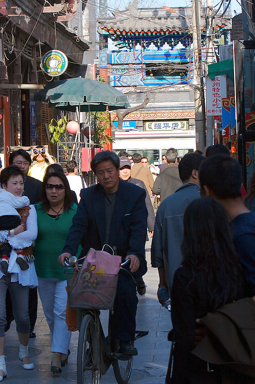 The crowded old style streets of the Shichahai area in Beijing,China.