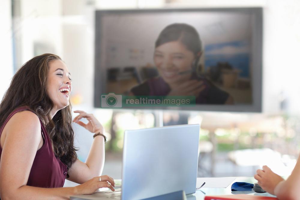 Businesswoman laughing in meeting (Credit Image: © Image Source/Albert Van Rosendaa/Image Source/ZUMAPRESS.com)